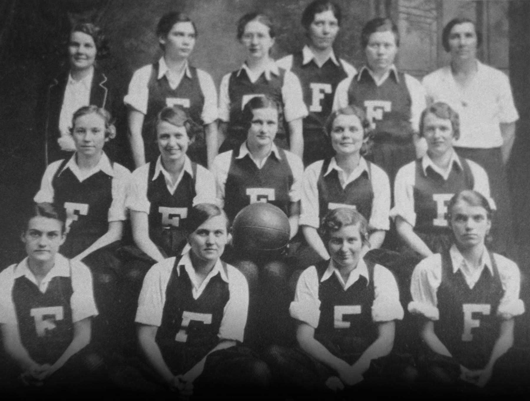1931: Basketball Squad poses for a team portrait